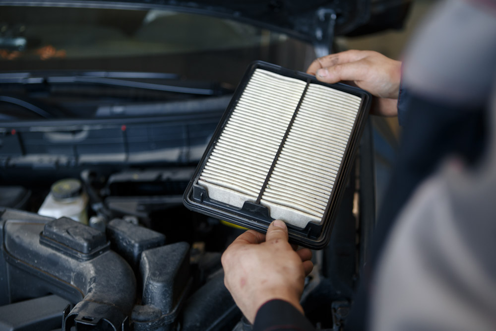 replacement of car air filter by auto mechanic
